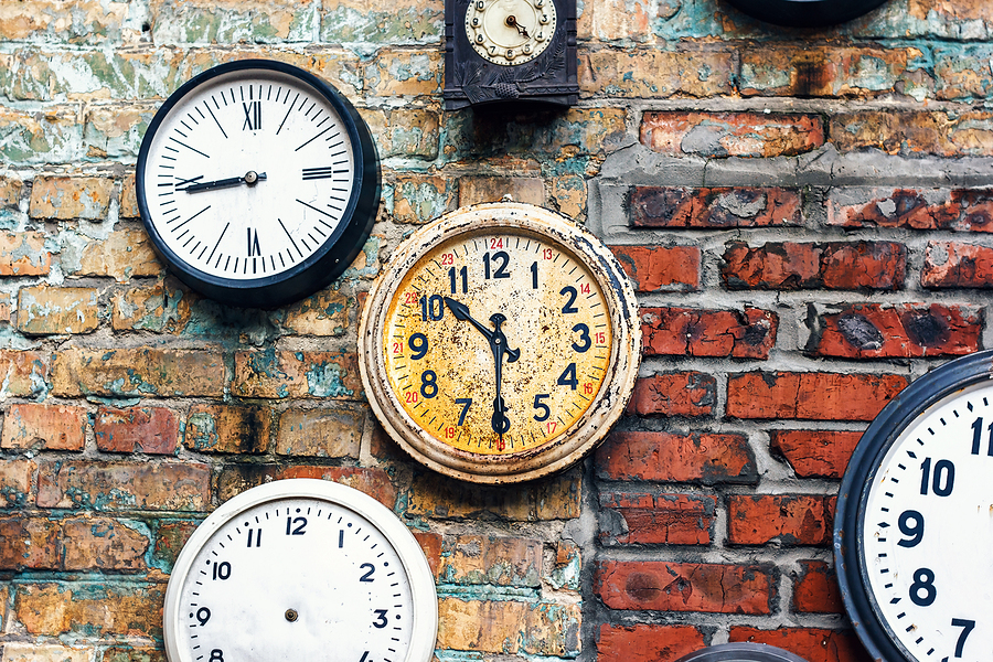 Grunge background with old watch. Time concept. Retro clocks on the wall. Old antique clock on aged red brick wall background. Vintage clocks.