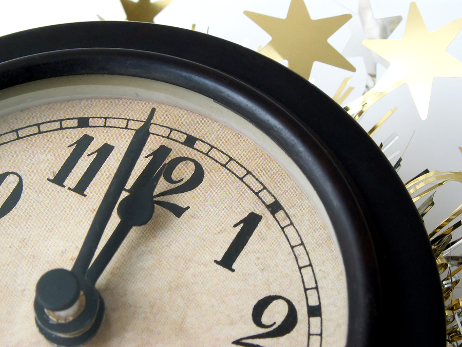 clock about to strike midnight on new year's eve