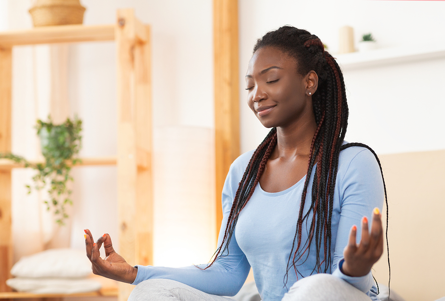Meditation. Peaceful African American Woman Meditating Sitting In Lotus Yoga Pose In Bed Relaxing At Home. Selective Focus