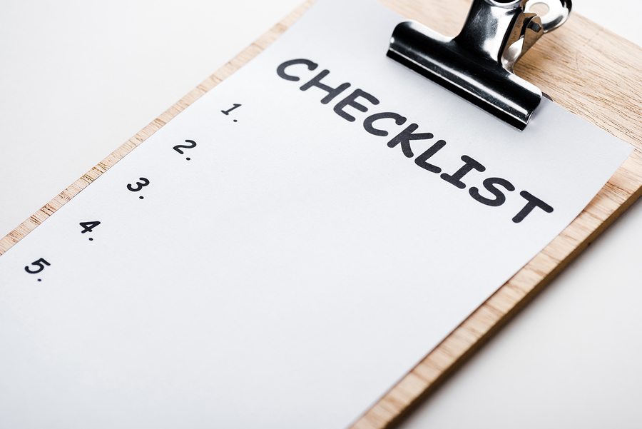 wooden clipboard with checklist lettering on paper isolated on white