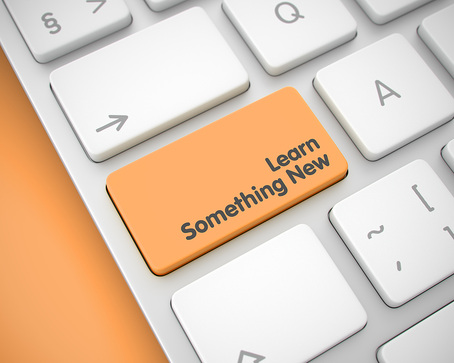 Online Service Concept: Learn Something New on Modernized Keyboard lying on Orange Background. Message on Keyboard Enter Button, for Learn Something New Concept. 3D Illustration.