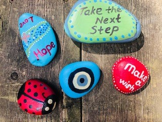 Painted rocks, creative outlet, message of hope.