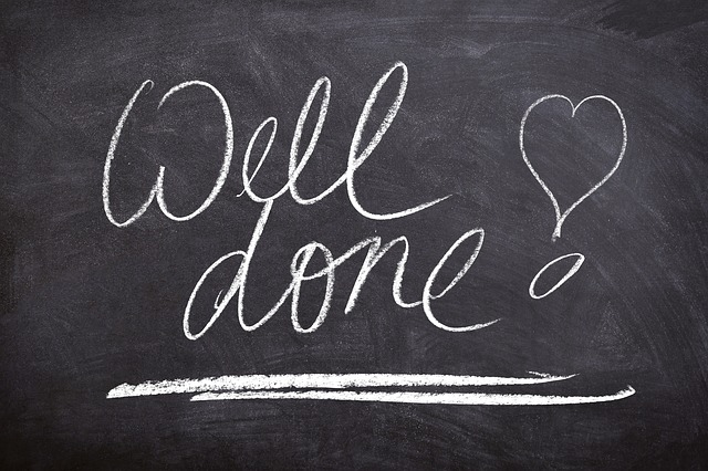 "A chalkboard sign saying, ""Well done!"""